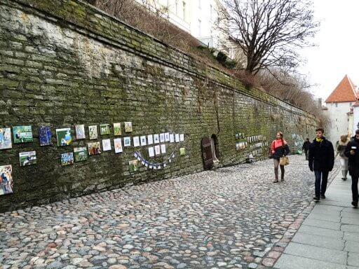The town wall in Tallinn Old Town guarded Tallinn and was built sometime around the 14th century to defend it against medieval invaders. As you walk up the Toompea Hill, you can see art works by local artists on the walls.