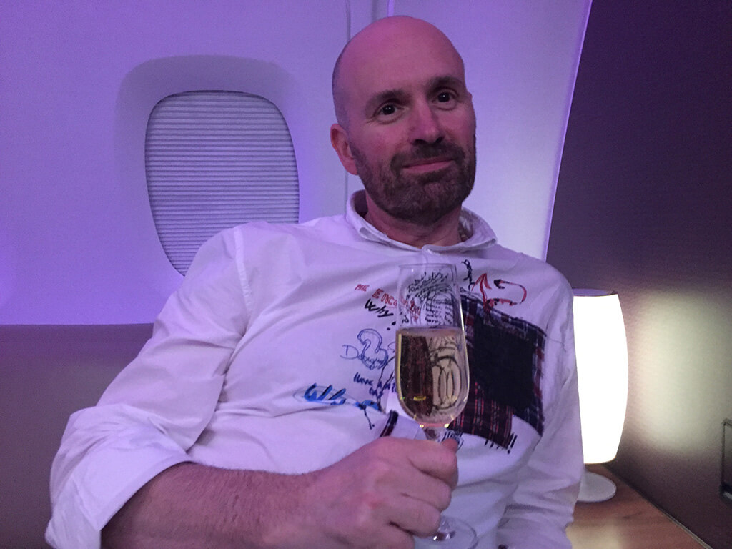 Andy drinking champagne in the bar on our first Qatar Airways A380 flight en-route to Bali