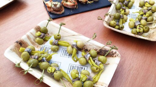 Gilda pintxos with Ibarra peppers, anchovies and olives. From humble origins as a snack served in the taverns in the Basque Country, pintxos are now a food art form.