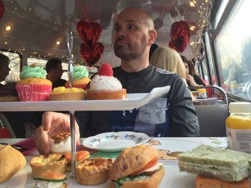 Andy tries not to look as though he's trying the treats on the B Bakery Afternoon Tea Bus Tour