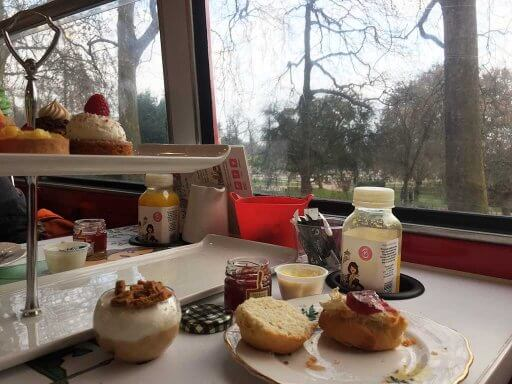 Indulging in cakes as we pass Kensington Gardens on the B Bakery Afternoon Tea Bus Tour