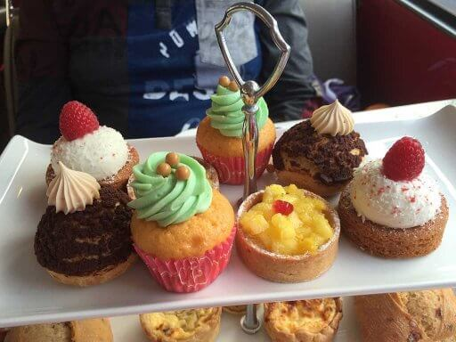Sweet treats on the top tier of the tea stand on the B Bakery Afternoon Tea Bus Tour