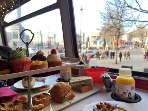 Enjoying the scrummy food on B Bakery Afternoon Tea Bus Tour as we pass through Trafalgar Square