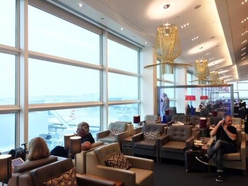 The lounge then opens up with seating areas that run along the windows. We found ourselves a spot by the window, which gave us a great view over the runway.