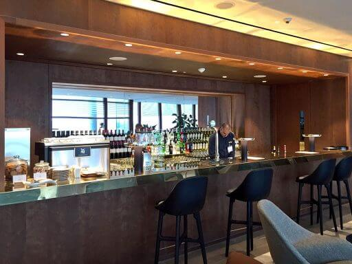 There's a well stocked bar at the Cathay Pacific lounges at Heathrow Terminal 3