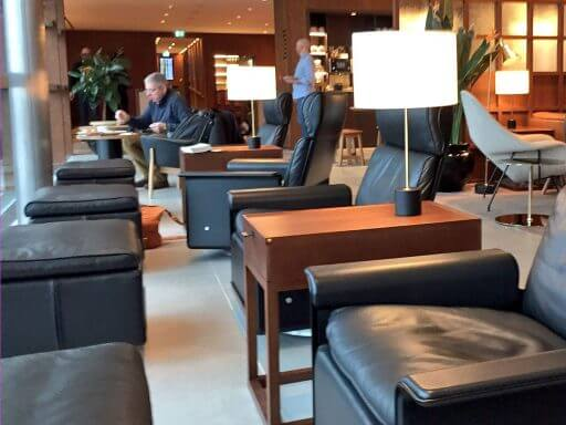 Relax in the comfy bespoke seating at the Cathay Pacific lounges at Heathrow Terminal 3