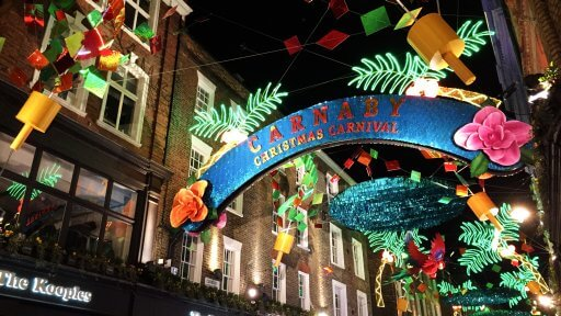 Having taken Soho back to the groovy 60s last year, this year's display is all themed around a totally tropical party. The Carnaby Christmas Carnival has taken over fourteen streets transforming them with a blaze of colour.