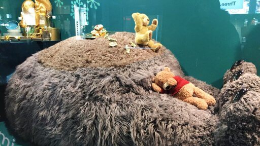 """Sticking to the annual tradition of referencing its famed Christmas advert, the star of this year's John Lewis festive windows is Moz the Monster. The display is, unsurprisingly, their first """"farting and snoring"""" Christmas window, and sees the two-metre-tall, fluffy giant relaxing at home in various different scenarios."""