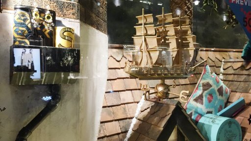 Liberty's fantastic display puts the store itself firmly at the centre of its Christmas windows. The centrepiece of the design is the stores 150-year-old iconic rooftop. Dusted with snow, the rooftops highlight some of the amazing items that can be found in the store.