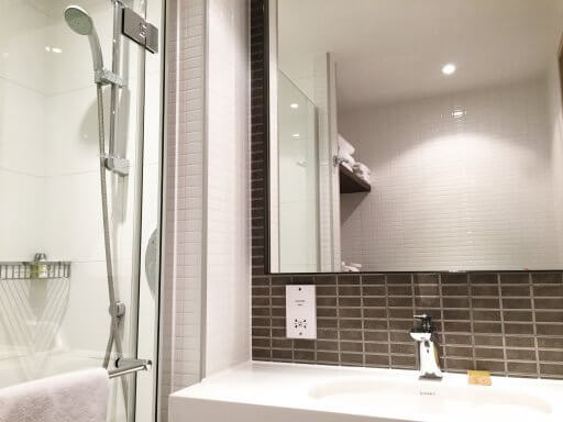 """The bathrooms at the Doubletree Tower Hill can best be described as """"compact"""". They certainly don't lack in the facilities front, with a decent size sink and a walk-in power shower."""