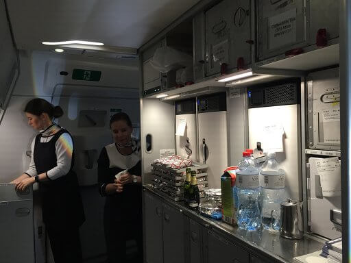 Cabin crew busy in the front galley making breakfast on the Finnair A350 Business Class return flight to Heathrow