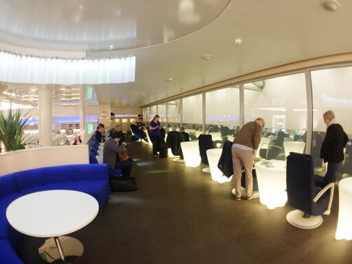The Finnair Non-Schengen Lounge at Helsinki Airport has a comfy mezzanine seating area with views over the runway