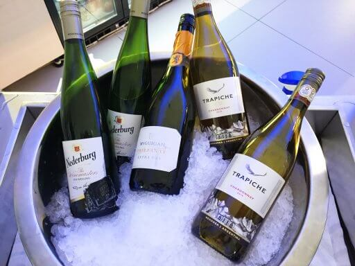 A selection of chilled white wines on ice in the Finnair Non-Schengen Lounge at Helsinki Airport