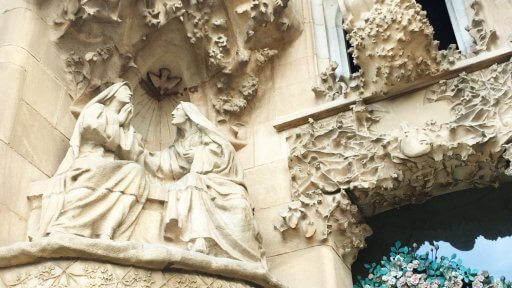 The Sagrada Família's Nativity façade has four towers and three doors. Its outstanding feature is the elaborate decoration, replete with Christian symbols. The sculptures extend from the bottom of the façade to where the bell towers start to rise. Through them, the façade depicts the birth of Christ.