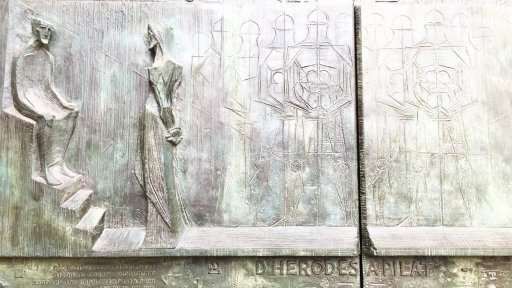 The Passion façade is full of hard angles, stark images, and straining scenes – all designed to evoke the pain & suffering of Jesus' final moments on earth. The doors themselves tell the story of the Passion of Christ, actual text from the Gospel of John written in Catalan.