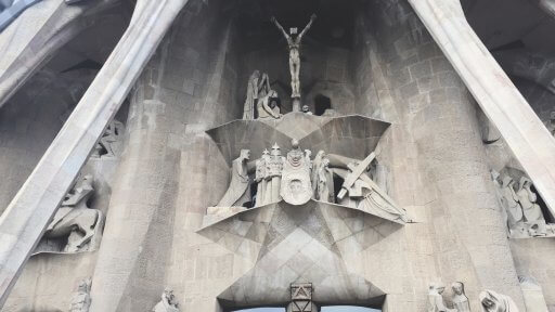 There are 16 scenes on the Passion façade. Here the level above the door shows Christ carrying the cross and Veronica with the image of Jesus on her veil. The crucifixion of Jesus is on the top level.