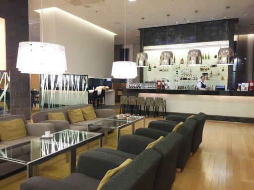 The bar at Hilton Helsinki Airport has many different comfy seating areas for you to relax and enjoy a drink.