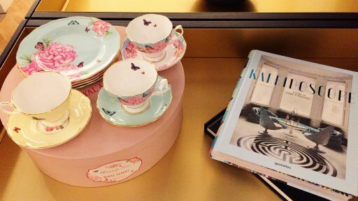Afternoon tea in the Qantas London Lounge, complete with scones, jam and cream, is served on elegant Royal Albert crockery decorated by Miranda Kerr.