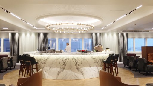 Upstairs, there's a circular marble bar, which dominates the runway side of the upper floor. There's a good range of Australian and New Zealand wines as well as a couple of French ones. They also offer sparkling wines & Perrier-Jouët Champagne.