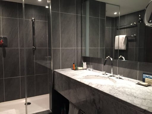 Walk-in shower in an Executive room bathroom at the Hilton Vienna Plaza